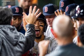 HOUSTON, TX - OCTOBER 17: Mookie Betts #50 of the Boston Red Sox high fives teammates after scoring during the first inning of game four of the American League Championship Series against the Houston Astros on October 17, 2018 at Minute Maid Park in Houston, Texas. (Photo by Billie Weiss/Boston Red Sox/Getty Images) *** Local Caption *** Mookie Betts