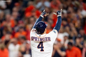 HOUSTON, TX - OCTOBER 17: George Springer #4 of the Houston Astros is greeted at home plate after hitting a solo home run in the third inning during Game 4 of the ALCS against the Boston Red Sox at Minute Maid Park on Wednesday, October 17, 2018 in Houston, Texas. (Photo by Billie Weiss/Boston Red Sox/Getty Images) *** Local Caption *** George Springer