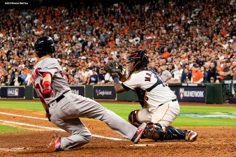 HOUSTON, TX - OCTOBER 17: Andrew Benintendi #16 of the Boston Red Sox scores a run in the fifth inning as Martin Maldonado #15 of the Houston Astros is unable to make the tag during Game Four of the American League Championship Series at Minute Maid Park on October 17, 2018 in Houston, Texas. (Photo by Billie Weiss/Boston Red Sox/Getty Images) *** Local Caption *** Andrew Benintendi; Martin Maldonado