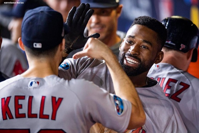 HOUSTON, TX - OCTOBER 17: Jackie Bradley Jr. #19 of the Boston Red Sox reacts with teammates after hitting a two-run home run during the sixth inning of game four of the American League Championship Series against the Houston Astros on October 17, 2018 at Minute Maid Park in Houston, Texas. (Photo by Billie Weiss/Boston Red Sox/Getty Images) *** Local Caption *** Jackie Bradley Jr.