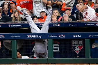 HOUSTON, TX - OCTOBER 17: Steve Pearce #25 of the Boston Red Sox falls over the dugout fence as he attempts to catch a foul ball during the seventh inning of game four of the American League Championship Series against the Houston Astros on October 17, 2018 at Minute Maid Park in Houston, Texas. (Photo by Billie Weiss/Boston Red Sox/Getty Images) *** Local Caption *** Steve Pearce