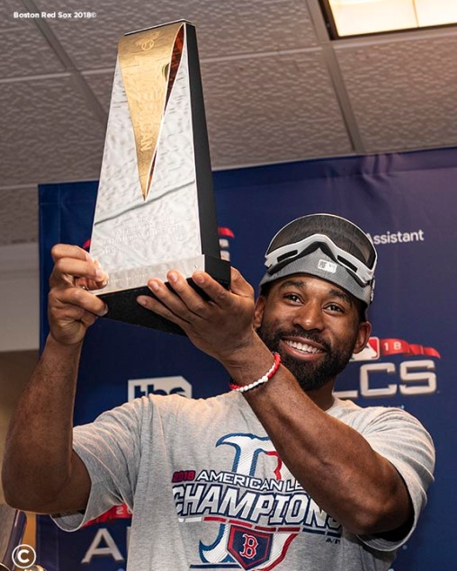 HOUSTON, TX - OCTOBER 18: Jackie Bradley Jr. #19 of the Boston Red Sox is presented with the American League Championship Most Valuable Player trophy in the clubhouse after clinching the American League Championship Series in game five against the Houston Astros on October 18, 2018 at Minute Maid Park in Houston, Texas. (Photo by Billie Weiss/Boston Red Sox/Getty Images) *** Local Caption *** Jackie Bradley Jr.