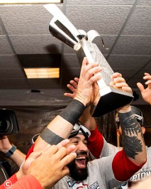 HOUSTON, TX - OCTOBER 18: Sandy Leon #3 of the Boston Red Sox celebrates with the American League Championship Series trophy in the clubhouse after clinching the American League Championship Series in game five against the Houston Astros on October 18, 2018 at Minute Maid Park in Houston, Texas. (Photo by Billie Weiss/Boston Red Sox/Getty Images) *** Local Caption ***Sandy Leon