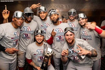 HOUSTON, TX - OCTOBER 18:Rafael Devers #11, Xander Bogaerts #2, Hector Velazquez #76, Eduardo Rodriguez #52, Eduardo Nunez #36, Steve Pearce #25, Christian Vazquez #7, and Andrew Benintendi #16 of the Boston Red Sox pose for a photograph with the American League Championship Series trophy in the clubhouse after clinching the American League Championship Series in game five against the Houston Astros on October 18, 2018 at Minute Maid Park in Houston, Texas. (Photo by Billie Weiss/Boston Red Sox/Getty Images) *** Local Caption ***Rafael Devers; Xander Bogaerts; Hector Velazquez; Eduardo Rodriguez; Eduardo Nunez; Christian Vazquez; Steve Pearce; Andrew Benintendi