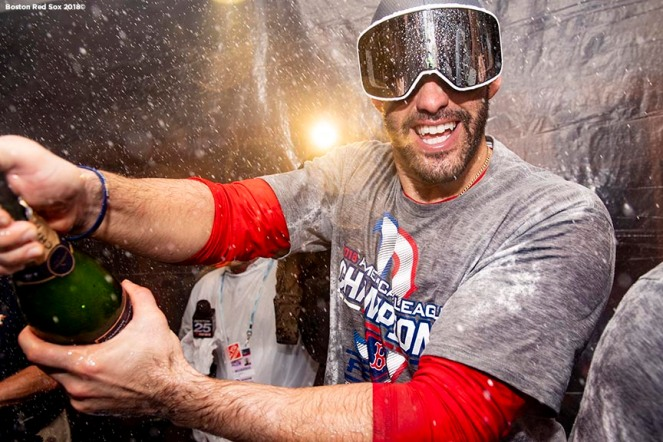 HOUSTON, TX - OCTOBER 18: J.D. Martinez #28 of the Boston Red Sox celebrates with champagne in the clubhouse after clinching the American League Championship Series in game five against the Houston Astros on October 18, 2018 at Minute Maid Park in Houston, Texas. (Photo by Billie Weiss/Boston Red Sox/Getty Images) *** Local Caption ***J.D. Martinez