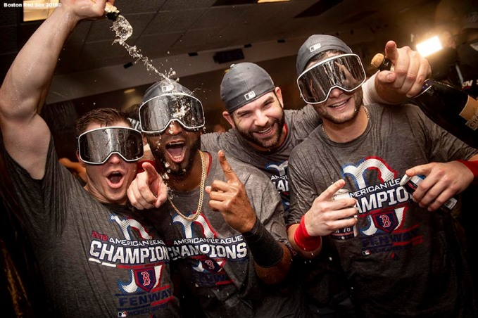 HOUSTON, TX - OCTOBER 18: Brock Holt #12, Eduardo Nunez #36, Mitch Moreland #18, and Andrew Benintendi #16of the Boston Red Sox celebrate with champagne in the clubhouse after clinching the American League Championship Series in game five against the Houston Astros on October 18, 2018 at Minute Maid Park in Houston, Texas. (Photo by Billie Weiss/Boston Red Sox/Getty Images) *** Local Caption ***Brock Holt; Eduardo Nunez; Mitch Moreland; Andrew Benintendi