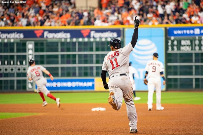 HOUSTON, TX - OCTOBER 18: Rafael Devers #11 of the Boston Red Sox reacts after hitting a three run home run during the sixth inning of game five of the American League Championship Series against the Houston Astros on October 18, 2018 at Minute Maid Park in Houston, Texas. (Photo by Billie Weiss/Boston Red Sox/Getty Images) *** Local Caption *** Rafael Devers