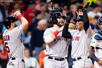 HOUSTON, TX - OCTOBER 18: Rafael Devers #11 of the Boston Red Sox reacts with Mitch Moreland #18 and Ian Kinsler #5 after hitting a three run home run during the sixth inning of game five of the American League Championship Series against the Houston Astros on October 18, 2018 at Minute Maid Park in Houston, Texas. (Photo by Billie Weiss/Boston Red Sox/Getty Images) *** Local Caption *** Rafael Devers; Mitch Moreland; Ian Kinsler