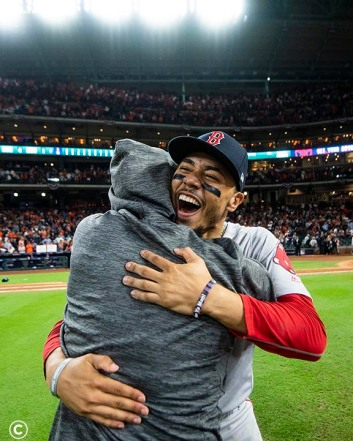 HOUSTON, TX - OCTOBER 18: Mookie Betts #50 of the Boston Red Sox celebrates after clinching the American League Championship Series in game five against the Houston Astros on October 18, 2018 at Minute Maid Park in Houston, Texas. (Photo by Billie Weiss/Boston Red Sox/Getty Images) *** Local Caption *** Mookie Betts