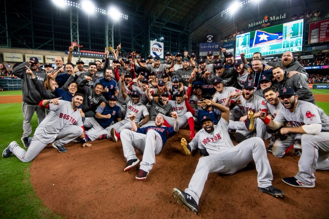 HOUSTON, TX - OCTOBER 18: Members of the Boston Red Sox pose for a team photograph as they celebrate after clinching the American League Championship Series in game five against the Houston Astros on October 18, 2018 at Minute Maid Park in Houston, Texas. (Photo by Billie Weiss/Boston Red Sox/Getty Images) *** Local Caption ***