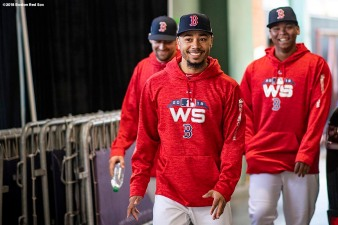 BOSTON, MA - OCTOBER 22: Mookie Betts #50, Nathan Eovaldi #17, and Rafael Devers #11 of the Boston Red Sox react during a workout before the 2018 World Series on October 22, 2018 at Fenway Park in Boston, Massachusetts. (Photo by Billie Weiss/Boston Red Sox/Getty Images) *** Local Caption *** Mookie Betts; Nathan Eovaldi; Rafael Devers