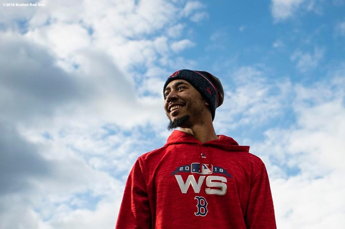 BOSTON, MA - OCTOBER 22: Mookie Betts #50 of the Boston Red Sox looks on during a workout before the 2018 World Series on October 22, 2018 at Fenway Park in Boston, Massachusetts. (Photo by Billie Weiss/Boston Red Sox/Getty Images) *** Local Caption *** Mookie Betts