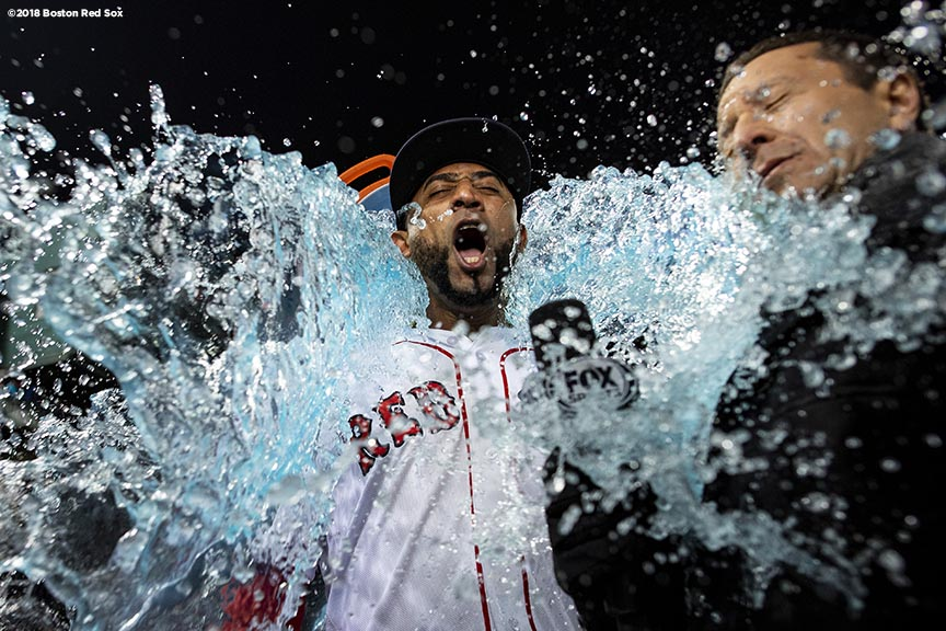 BOSTON, MA - OCTOBER 23: Eduardo Nunez #36 of the Boston Red Sox is doused with Gatorade after game one of the 2018 World Series against the Los Angeles Dodgers on October 23, 2018 at Fenway Park in Boston, Massachusetts. (Photo by Billie Weiss/Boston Red Sox/Getty Images) *** Local Caption *** Eduardo Nunez