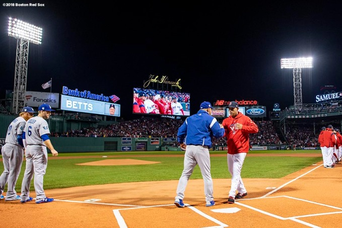 BOSTON, MA - OCTOBER 23: Manager Alex Cora of the Boston Red Sox high fives manager Dave Roberts of the Los Angeles Dodgers as they are introduced before game one of the 2018 World Series on October 23, 2018 at Fenway Park in Boston, Massachusetts. (Photo by Billie Weiss/Boston Red Sox/Getty Images) *** Local Caption *** Alex Cora; Dave Roberts