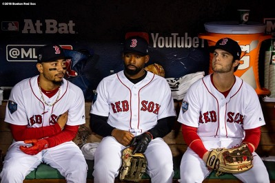 BOSTON, MA - OCTOBER 23: Mookie Betts #50, Jackie Bradley Jr. #19, and Andrew Benintendi #16 of the Boston Red Sox look on in the dugout before game one of the 2018 World Series against the Los Angeles Dodgers on October 23, 2018 at Fenway Park in Boston, Massachusetts. (Photo by Billie Weiss/Boston Red Sox/Getty Images) *** Local Caption *** Mookie Betts; Andrew Benintendi; Jackie Bradley Jr.
