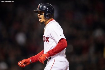 BOSTON, MA - OCTOBER 23: Mookie Betts #50 of the Boston Red Sox reacts after hitting a single during the first inning of game one of the 2018 World Series against the Los Angeles Dodgers on October 23, 2018 at Fenway Park in Boston, Massachusetts. (Photo by Billie Weiss/Boston Red Sox/Getty Images) *** Local Caption *** Mookie Betts