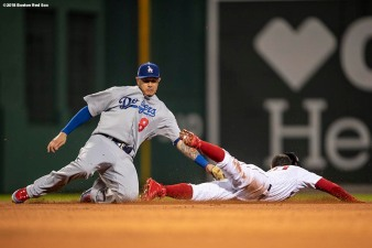 BOSTON, MA - OCTOBER 23: Mookie Betts #50 of the Boston Red Sox evades the tag of Manny Machado #8 of the Los Angeles Dodgers as he steals second base during the first inning of game one of the 2018 World Series on October 23, 2018 at Fenway Park in Boston, Massachusetts. (Photo by Billie Weiss/Boston Red Sox/Getty Images) *** Local Caption *** Manny Machado; Mookie Betts