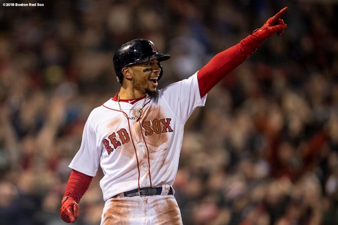 BOSTON, MA - OCTOBER 23: Mookie Betts #50 of the Boston Red Sox reacts as he scores during the first inning of game one of the 2018 World Series against the Los Angeles Dodgers on October 23, 2018 at Fenway Park in Boston, Massachusetts. (Photo by Billie Weiss/Boston Red Sox/Getty Images) *** Local Caption *** Mookie Betts