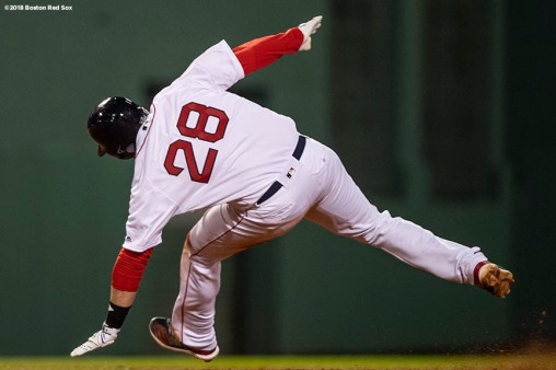 BOSTON, MA - OCTOBER 23: J.D. Martinez #28 of the Boston Red Sox injures himself rounding second base after hitting an RBI double during the third inning of game one of the 2018 World Series against the Los Angeles Dodgers on October 23, 2018 at Fenway Park in Boston, Massachusetts. (Photo by Billie Weiss/Boston Red Sox/Getty Images) *** Local Caption *** J.D. Martinez