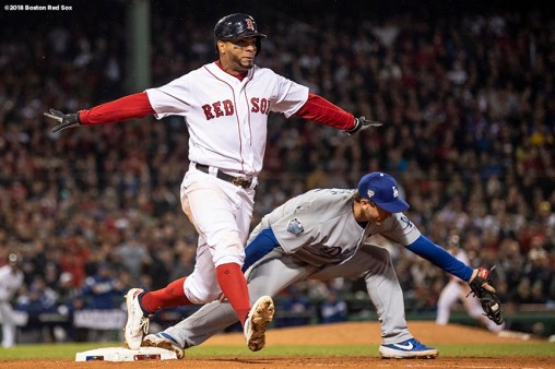 BOSTON, MA - OCTOBER 23: Xander Bogaerts #2 of the Boston Red Sox reacts as he beats out a fielder's choice during the fifth the inning of game one of the 2018 World Series against the Los Angeles Dodgers on October 23, 2018 at Fenway Park in Boston, Massachusetts. (Photo by Billie Weiss/Boston Red Sox/Getty Images) *** Local Caption *** Xander Bogaerts