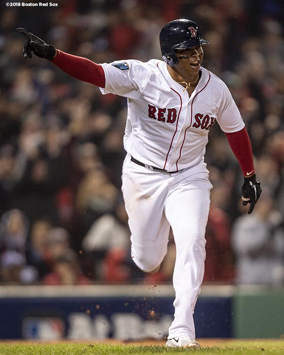 BOSTON, MA - OCTOBER 23: Rafael Devers #11 of the Boston Red Sox reacts after hitting an RBI single during the fifth inning of game one of the 2018 World Series against the Los Angeles Dodgers on October 23, 2018 at Fenway Park in Boston, Massachusetts. (Photo by Billie Weiss/Boston Red Sox/Getty Images) *** Local Caption *** Rafael Devers