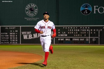 BOSTON, MA - OCTOBER 24: Mookie Betts #50 of the Boston Red Sox warms up before game two of the 2018 World Series against the Los Angeles Dodgers on October 23, 2018 at Fenway Park in Boston, Massachusetts. (Photo by Billie Weiss/Boston Red Sox/Getty Images) *** Local Caption *** Mookie Betts