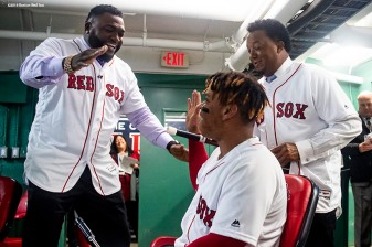 BOSTON, MA - OCTOBER 24: Former designated hitter David Ortiz and former pitcher Pedro Martinez react with Rafael Devers #11 of the Boston Red Sox before game two of the 2018 World Series against the Los Angeles Dodgers on October 23, 2018 at Fenway Park in Boston, Massachusetts. (Photo by Billie Weiss/Boston Red Sox/Getty Images) *** Local Caption *** David Ortiz; Rafael Devers; Pedro Martinez