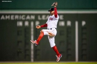 BOSTON, MA - OCTOBER 24: Ian Kinsler #5 of the Boston Red Sox leaps as he catches a line drive during the third inning of game two of the 2018 World Series against the Los Angeles Dodgers on October 23, 2018 at Fenway Park in Boston, Massachusetts. (Photo by Billie Weiss/Boston Red Sox/Getty Images) *** Local Caption *** Ian Kinsler