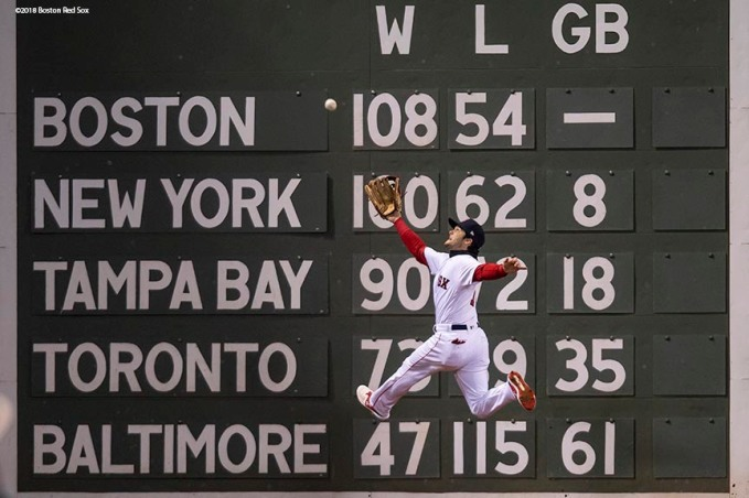 BOSTON, MA - OCTOBER 24: Andrew Benintendi #16 of the Boston Red Sox makes a leaping catch against the wall on a ball hit by Brian Dozier of the Los Angeles Dodgers during the fifth inning of game two of the 2018 World Series on October 23, 2018 at Fenway Park in Boston, Massachusetts. (Photo by Billie Weiss/Boston Red Sox/Getty Images) *** Local Caption *** Andrew Benintendi