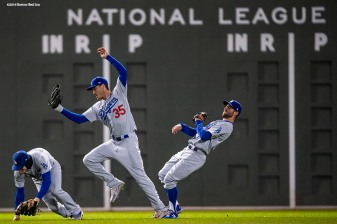 BOSTON, MA - OCTOBER 24: Cody Bellinger #35 and Chris Taylor #3 of the Los Angeles Dodgers attempt to catch a fly ball during Game 2 of the 2018 World Series against the Boston Red Sox at Fenway Park on Wednesday, October 24, 2018 in Boston, Massachusetts. (Photo by Billie Weiss/Boston Red Sox/Getty Images) *** Local Caption *** Cody Bellinger; Chris Taylor