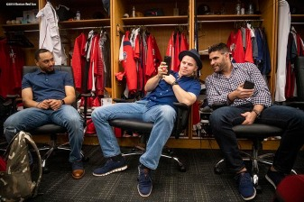 BOSTON, MA - OCTOBER 25: Mookie Betts #50, Brock Holt #12, and J.D. Martinez #28 of the Boston Red Sox talk in the clubhouse as they travel to Los Angeles before game three of the 2018 World Series against the Los Angeles Dodgers on October 25, 2018 at Fenway Park in Boston, Massachusetts. (Photo by Billie Weiss/Boston Red Sox/Getty Images) *** Local Caption *** Mookie Betts; Brock Holt; J.D. Martinez