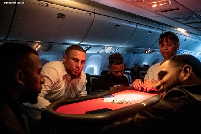 BOSTON, MA - OCTOBER 25: Eduardo Nunez #36, Christian Vazquez #7, Xander Bogaerts #2, Rafael Devers #11, and Eduardo Rodriguez #52 of the Boston Red Sox play cards on the plane as they travel to Los Angeles before game three of the 2018 World Series against the Los Angeles Dodgers on October 25, 2018 at Fenway Park in Boston, Massachusetts. (Photo by Billie Weiss/Boston Red Sox/Getty Images) *** Local Caption *** Christian Vazquez; Rafael Devers; Eduardo Nunez; Eduardo Rodriguez; Xander Bogaerts
