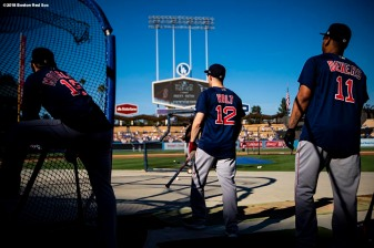 LOS ANGELES, CA - OCTOBER 26: Mitch Moreland #18, Brock Holt #12 and Rafael Devers #11 of the Boston Red Sox look on during batting practice before game three of the 2018 World Series against the Los Angeles Dodgers on October 26, 2018 at Dodger Stadium in Los Angeles, California. (Photo by Billie Weiss/Boston Red Sox/Getty Images) *** Local Caption *** Brock Holt; Mitch Moreland; Rafael Devers