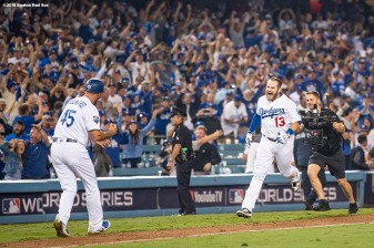 LOS ANGELES, CA - OCTOBER 26: Max Muncy #13 of the Los Angeles Dodgers celebrates his eighteenth inning walk-off home run to defeat the the Boston Red Sox 3-2 in Game Three of the 2018 World Series at Dodger Stadium on October 26, 2018 in Los Angeles, California. (Photo by Billie Weiss/Boston Red Sox/Getty Images) *** Local Caption *** Max Muncy