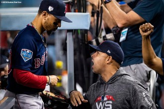 LOS ANGELES, CA - OCTOBER 26: Mookie Betts #50 of the Boston Red Sox high fives manager Alex Cora during the sixth inning of game three of the 2018 World Series against the Los Angeles Dodgers on October 26, 2018 at Dodger Stadium in Los Angeles, California. (Photo by Billie Weiss/Boston Red Sox/Getty Images) *** Local Caption *** Mookie Betts; Alex Cora