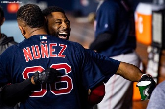 LOS ANGELES, CA - OCTOBER 26: Jackie Bradley Jr. #19 of the Boston Red Sox reacts with Eduardo Nunez #36 after hitting a game tying solo home run during the eighth inning of game three of the 2018 World Series against the Los Angeles Dodgers on October 26, 2018 at Dodger Stadium in Los Angeles, California. (Photo by Billie Weiss/Boston Red Sox/Getty Images) *** Local Caption *** Jackie Bradley Jr.; Eduardo Nunez