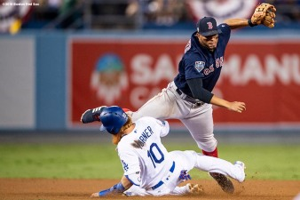 LOS ANGELES, CA - OCTOBER 26: Xander Bogaerts #2 of the Boston Red Sox attempts to turn a double play as Justin Turner #10 of the Los Angeles Dodgers slides into second base in the eighth inning during Game 3 of the 2018 World Series at Dodger Stadium on Friday, October 26, 2018 in Los Angeles, California. (Photo by Billie Weiss/Boston Red Sox/Getty Images) *** Local Caption *** Xander Bogaerts; Justin Turner