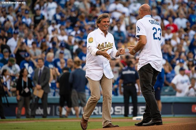 LOS ANGELES, CA - OCTOBER 27: Dennis Eckersley (L) and Kirk Gibson shake hands on the mound after Eckersley threw out the ceremonial first pitch to Gibson prior to in Game Four of the 2018 World Series between the Boston Red Sox and the Los Angeles Dodgers at Dodger Stadium on October 27, 2018 in Los Angeles, California. (Photo by Billie Weiss/Boston Red Sox/Getty Images) *** Local Caption *** Dennis Eckersley; Kirk Gibson