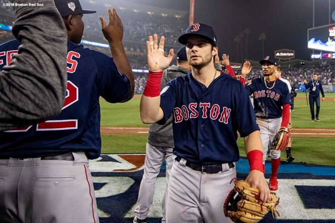 LOS ANGELES, CA - OCTOBER 27: Andrew Benintendi #16 of the Boston Red Sox high fives teammates after a victory in game four of the 2018 World Series against the Los Angeles Dodgers on October 27, 2018 at Dodger Stadium in Los Angeles, California. (Photo by Billie Weiss/Boston Red Sox/Getty Images) *** Local Caption *** Andrew Benintendi