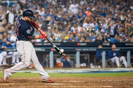LOS ANGELES, CA - OCTOBER 27: Steve Pearce #25 of the Boston Red Sox hits a game tying solo home run during the eighth inning of game four of the 2018 World Series against the Los Angeles Dodgers on October 27, 2018 at Dodger Stadium in Los Angeles, California. (Photo by Billie Weiss/Boston Red Sox/Getty Images) *** Local Caption *** Steve Pearce