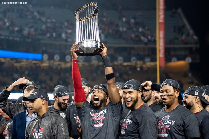 LOS ANGELES, CA - OCTOBER 28: Eduardo Nunez #36 of the Boston Red Sox holds up the World Series trophy after winning the 2018 World Series in game five against the Los Angeles Dodgers on October 28, 2018 at Dodger Stadium in Los Angeles, California. (Photo by Billie Weiss/Boston Red Sox/Getty Images) *** Local Caption *** Eduardo Nunez