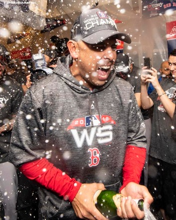 LOS ANGELES, CA - OCTOBER 28: Manager Alex Cora of the Boston Red Sox celebrates with champagne in the clubhouse after winning the 2018 World Series in game five of the 2018 World Series against the Los Angeles Dodgers on October 28, 2018 at Dodger Stadium in Los Angeles, California. (Photo by Billie Weiss/Boston Red Sox/Getty Images) *** Local Caption *** Alex Cora