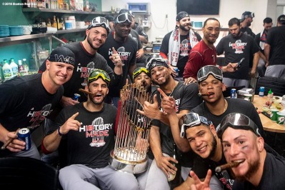 LOS ANGELES, CA - OCTOBER 28: Bobby Poyner #11, Steve Pearce #25, J.D. Martinez #28, Edaurdo Nunez #36, Xander Bogaerts #2, Mookie Betts #50, Rafael Devers #11, Eduardo Rodriguez #57, and Christian Vazquez #7 of the Boston Red Sox celebrate with the World Series trophy in the clubhouse after winning the 2018 World Series in game five of the 2018 World Series against the Los Angeles Dodgers on October 28, 2018 at Dodger Stadium in Los Angeles, California. (Photo by Billie Weiss/Boston Red Sox/Getty Images) *** Local Caption ***Bobby Poyner; Steve Pearce; J.D. Martinez; Eduardo Nunez; Xander Bogaerts; Rafael Devers; Mookie Betts; Eduardo Rodriguez; Christian Vazquez