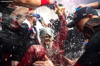 LOS ANGELES, CA - OCTOBER 28: Mookie Betts #50 of the Boston Red Sox celebrates with champagne in the clubhouse after winning the 2018 World Series in game five of the 2018 World Series against the Los Angeles Dodgers on October 28, 2018 at Dodger Stadium in Los Angeles, California. (Photo by Billie Weiss/Boston Red Sox/Getty Images) *** Local Caption ***Mookie Betts