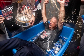 LOS ANGELES, CA - OCTOBER 28: President of Baseball Operations Dave Dombrowski of the Boston Red Sox celebrates with the World Series trophy as he is dunked in a bucket of beer after winning the 2018 World Series in game five of the 2018 World Series against the Los Angeles Dodgers on October 28, 2018 at Dodger Stadium in Los Angeles, California. (Photo by Billie Weiss/Boston Red Sox/Getty Images) *** Local Caption *** Dave Dombrowski