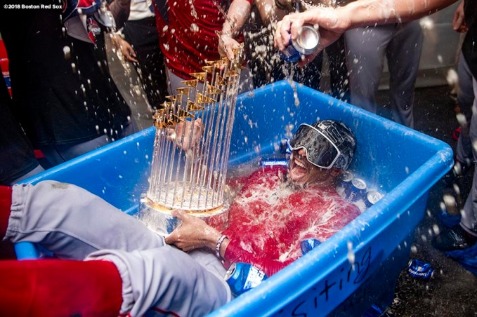 LOS ANGELES, CA - OCTOBER 28: Mookie Betts #50 of the Boston Red Sox celebrates with the World Series trophy as he is dunked in a bucket of beer after winning the 2018 World Series in game five of the 2018 World Series against the Los Angeles Dodgers on October 28, 2018 at Dodger Stadium in Los Angeles, California. (Photo by Billie Weiss/Boston Red Sox/Getty Images) *** Local Caption *** Mookie Betts