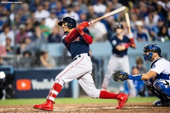 LOS ANGELES, CA - OCTOBER 28: Mookie Betts #50 of the Boston Red Sox hits a solo home run during the sixth inning of game five of the 2018 World Series against the Los Angeles Dodgers on October 28, 2018 at Dodger Stadium in Los Angeles, California. (Photo by Billie Weiss/Boston Red Sox/Getty Images) *** Local Caption *** Mookie Betts
