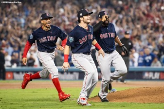 LOS ANGELES, CA - OCTOBER 28: Mookie Betts #50, Andrew Benintendi #16, and Jackie Bradley Jr. #19 of the Boston Red Sox react after the final out was recorded to win the 2018 World Series in game five against the Los Angeles Dodgers on October 28, 2018 at Dodger Stadium in Los Angeles, California. (Photo by Billie Weiss/Boston Red Sox/Getty Images) *** Local Caption *** Mookie Betts; Jackie Bradley Jr.; Andrew Benintendi