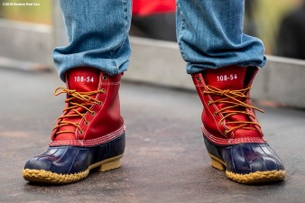 BOSTON, MA - OCTOBER 31: Brock Holt #12 of the Boston Red Sox wears LL Bean boots during the 2018 World Series rolling rally parade on October 31, 2018 in Boston, Massachusetts. (Photo by Billie Weiss/Boston Red Sox/Getty Images) *** Local Caption *** Brock Holt