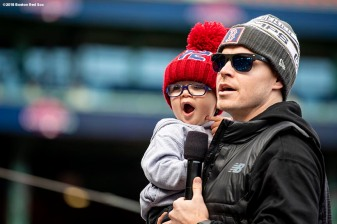 BOSTON, MA - OCTOBER 31: Brock Holt #12 of the Boston Red Sox is introduced with his son Griff during the 2018 World Series rolling rally parade on October 31, 2018 in Boston, Massachusetts. (Photo by Billie Weiss/Boston Red Sox/Getty Images) *** Local Caption *** Brock Holt